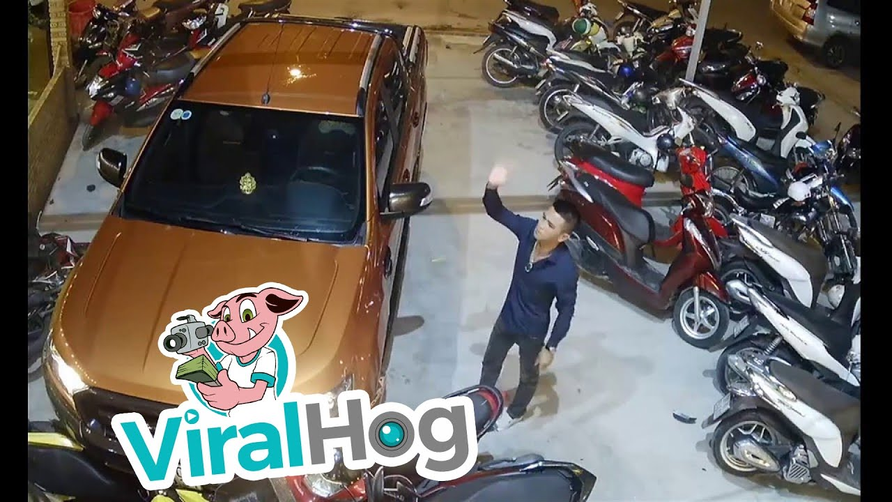 Funny Video: Car Crashes Into Scooter Dealership