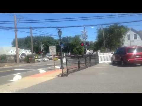 LIRR train passes Higbie Lane in west Islip NY