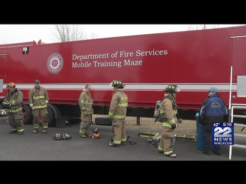 Firefighters train using a maze trailer