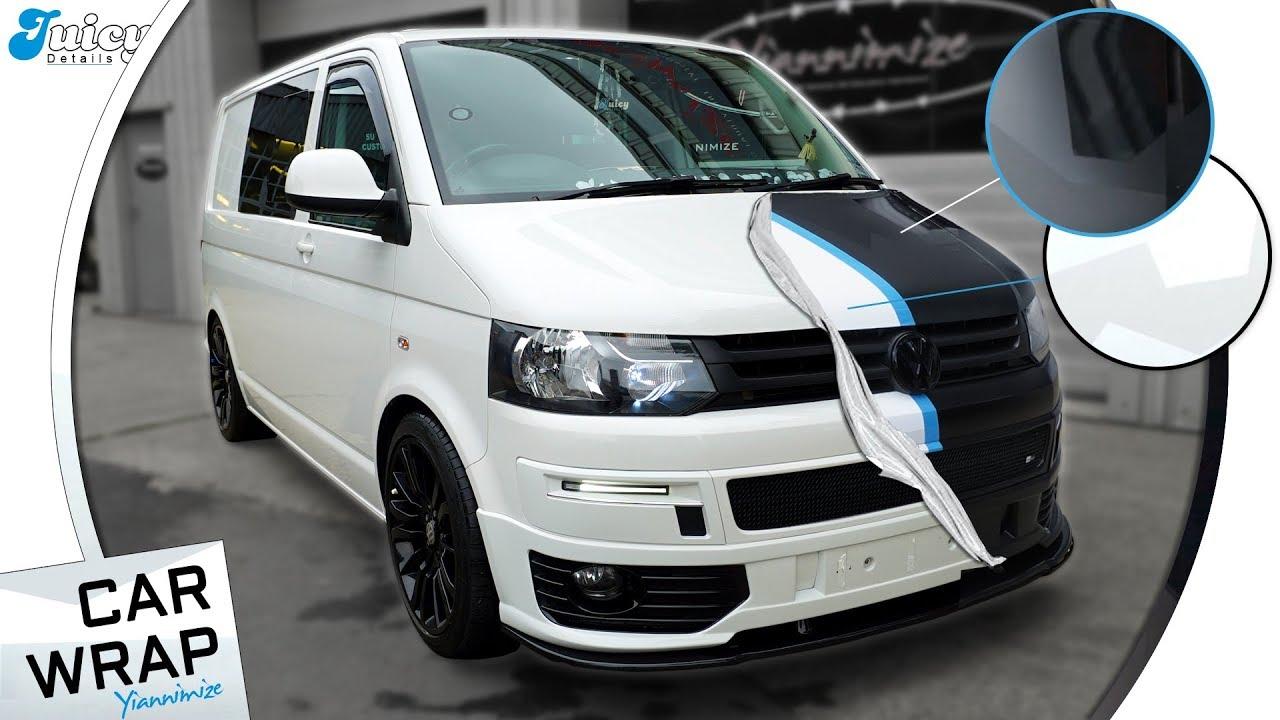 VW Transporter Van wrapped Half Black Camo, Half White Camo