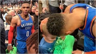 Russell Westbrook finds a kid in the stands and gives him his game shoes