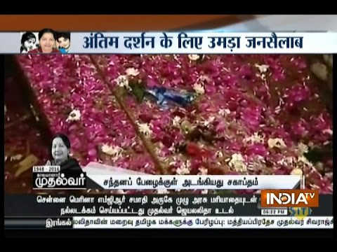 J Jayalalithaa laid to rest with full state honours next to mentor MGR's memorial at Marina Beach