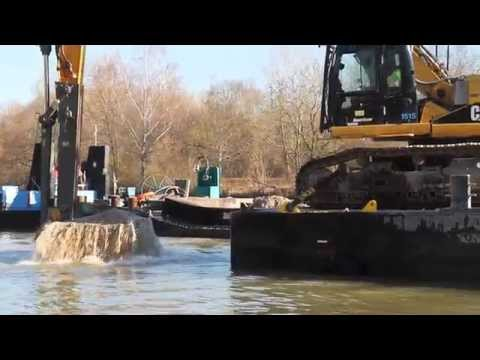 Caterpillar CAT 345D / DEM 70 on a pontoon