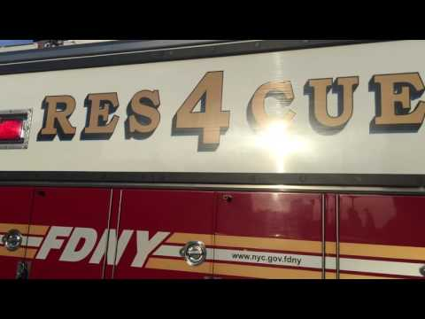 FDNY RESCUE 4 RETURNING TO QUARTERS ON QUEENS BOULEVARD IN WOODSIDE, QUEENS, NEW YORK CITY.