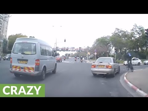 Crazy biker has close call with turning car