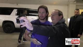 Mark Wahlberg talks about the New England Patriots outside the ArcLight Theatre in Hollywood