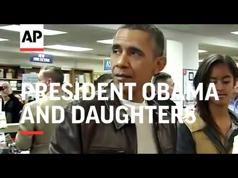 President Obama and daughters Malia and Sasha dropped in Saturday at Washington's Politics and Prose
