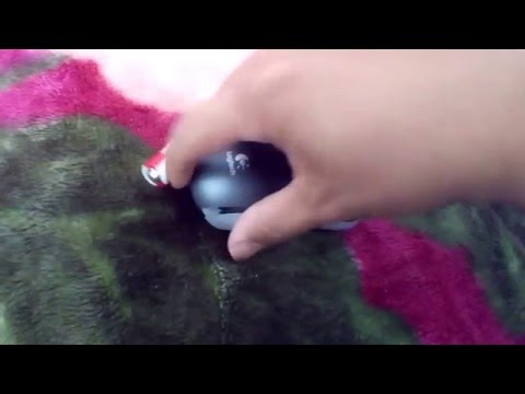 how to replace battery on logitech mouse m215