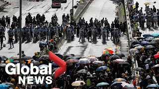 As Hong Kong marks handover anniversary, protesters get in scuffles with police