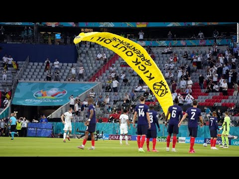 Germany vs. France: 'Kick out oil' protester parachutes into Allianz ...