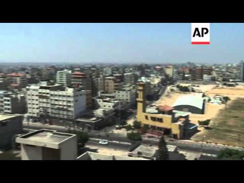 Israeli airstrike visible on skyline amid relative peace of ceasefire