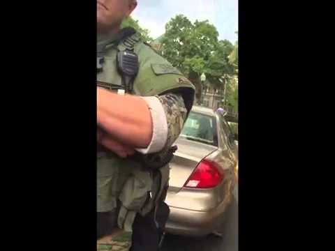 Man gets pulled over by armored car for flipping cops off