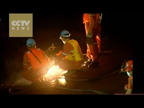 Rescuers cut into hull looking for more survivors