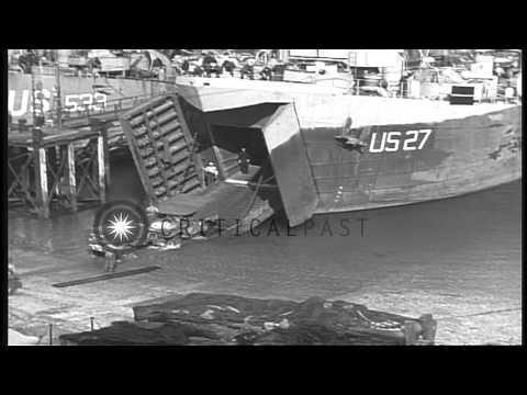 Army vehicles being loaded aboard LSTs (Landing Ship, Tank) near Falmouth, Englan...HD Stock Footage