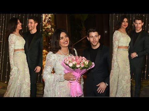 Omg omg ! Priyanka Chopra and Nick Jonas look superstunning couple at their Wedding Reception