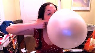 Blowing giant bubble gum bubbles with a whole roll of bubble tape!