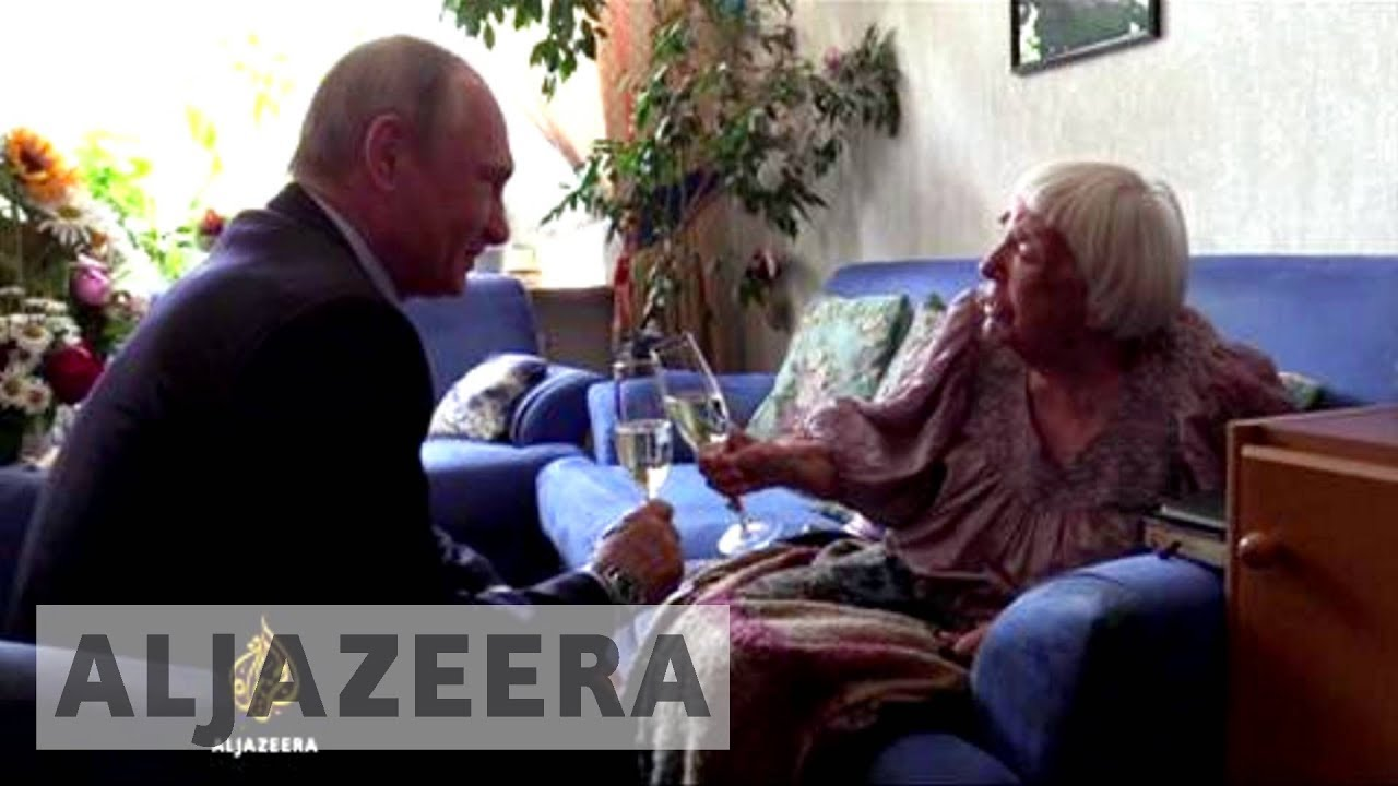 Russian human rights leader gets surprise birthday visit from Putin