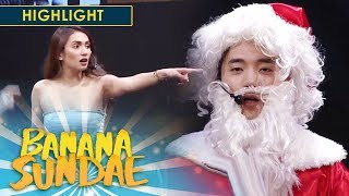 Santa Claus steals a kiss | Banana Sundae