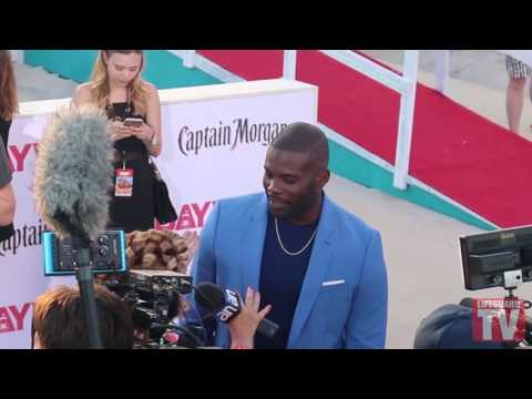 Lifeguard TV® Baywatch Movie Red Carpet s  Amin Joseph and Belinda