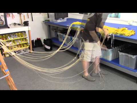 Installing a new parachute line set. Skydiving Services LLC