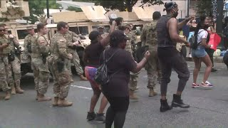 Watch: National Guard members dance with protesters in Downtown Atlanta