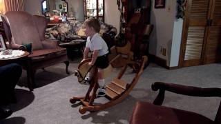 Grant Riding His Rocking Horse 6-6-10