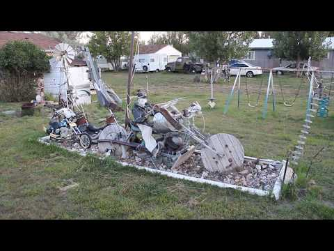 Biker Bill yard art in Medicine Bow, Wyoming (lots of electrical insulators)