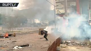Protesters clash with police, set govt building on fire in Quito, Ecuador