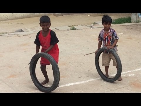 VILLAGE FUNNY VIDEO Waste tire game at village / Indian village kids Playing In Street/Village life