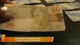 Dinheiro rasgado no numero de serie