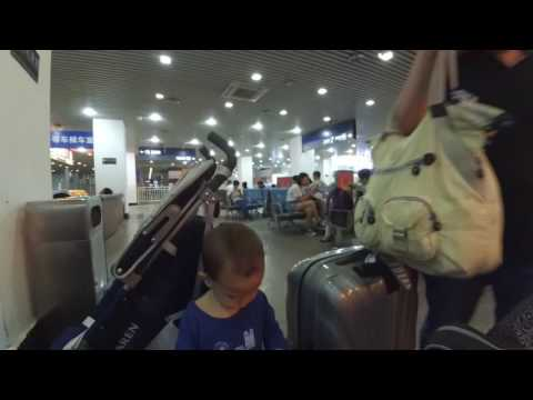 Back to China: draguing too many suitcases