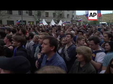 Police beat, arrest opposition protesters in Moscow