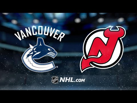 Hall's three points lead Devils past Canucks, 3-2