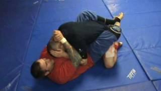 10th Planet Jiu Jitsu Technique: Slow Triangle from Guard (Part 1 of 2)