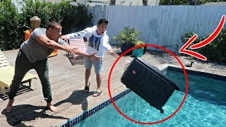 THROWING ROOMATES LUGGAGE IN THE POOL PRANK ($5000 LAPTOP INSIDE)