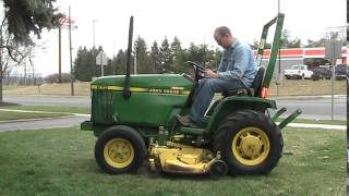 John Deere 670 Tractor 2WD with Belly Mower