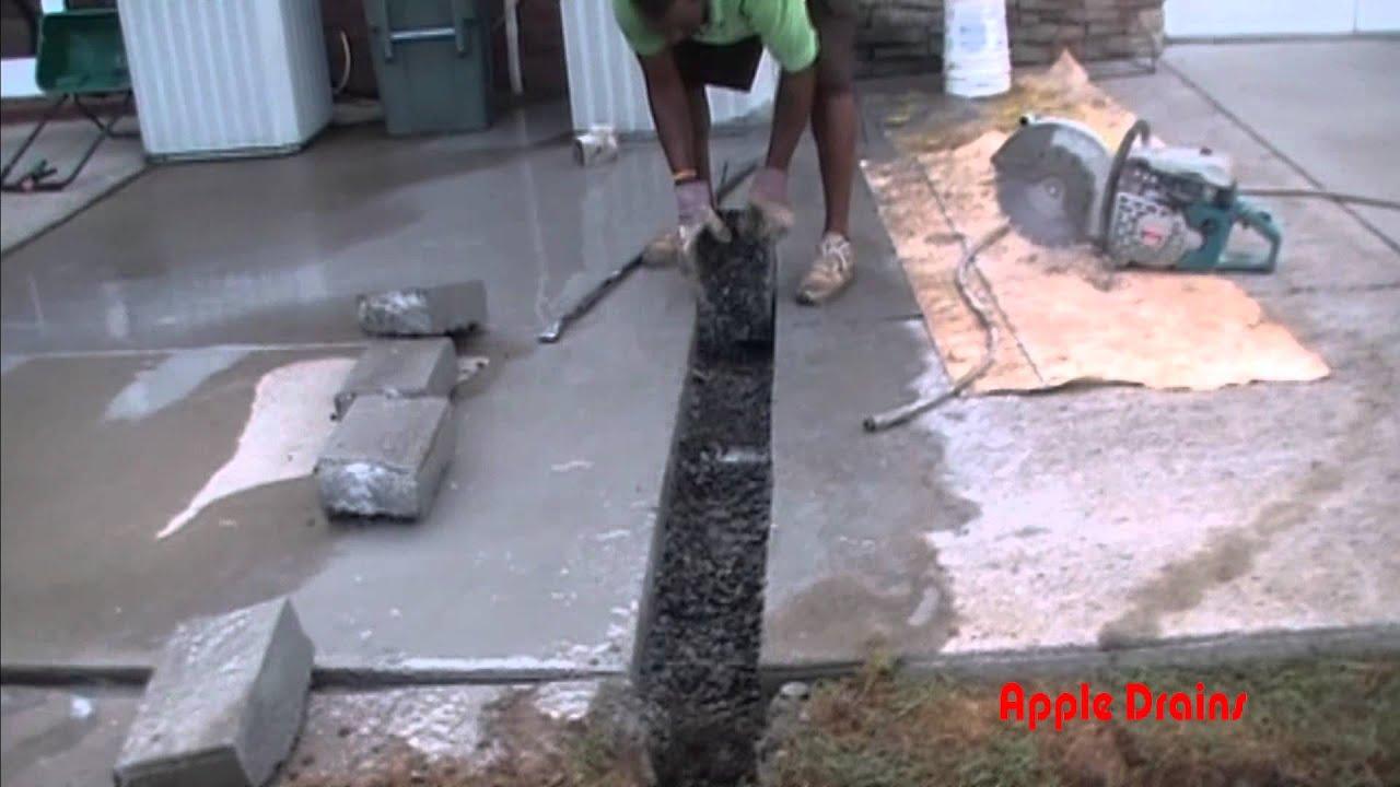 downspout drain under concrete how to cut remove concrete