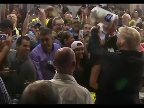 President Donald Trump throws toilet paper rolls at people in Puerto Rico relief after hurricane