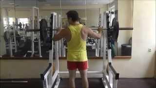 видео Классический жим штанги стоя: упражнение на плечи