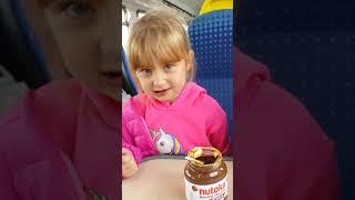 2019 August 15th Rowan and Amelia enjoying Nutella on the Blackburn to Bolton train.