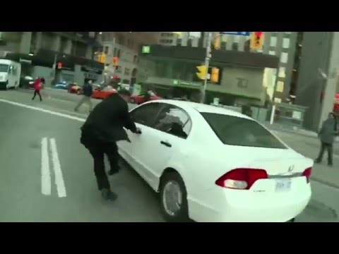 Taxi driver confronts a suspected Uber X driver in Toronto