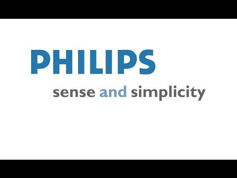 """Телефон Philips E120. Посылка с интернет - магазина """"Юлмарт"""". Доставка DHL"""