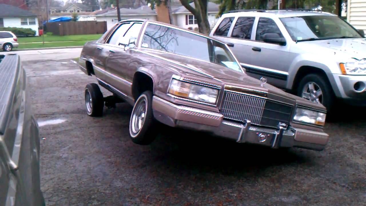 90 Cadillac fleetwood lowrider 3 wheel - YouTube