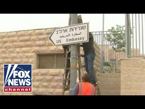 Officials in Jerusalem put up road signs for new US embassy