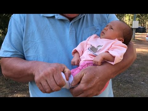 Baby Massage. Brandon Raynor Demonstrates Raynor Baby Massage On His Daughter