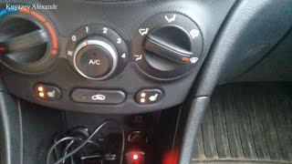 Як включити підігрів сидінь на кнопці?