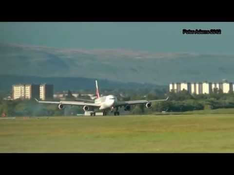 Emirates A340 land and depart runway 23  Glasgow 04 06 12.wmv