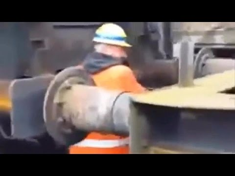 An Extremely Dangerous Technique To Connect Rail Cars