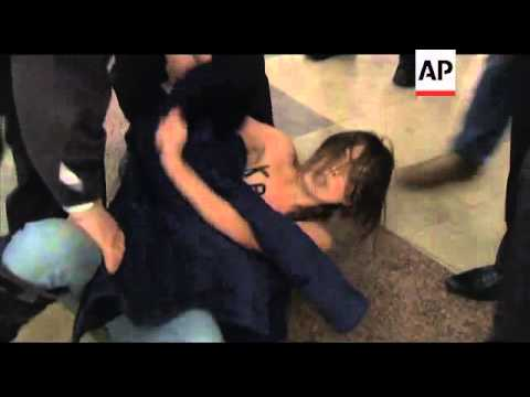 Women stage topless protest as Putin votes