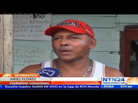 """""""Es mejor estar aquí"""": venezolanos improvisan refugios en lote de Cartagena, Colombia"""